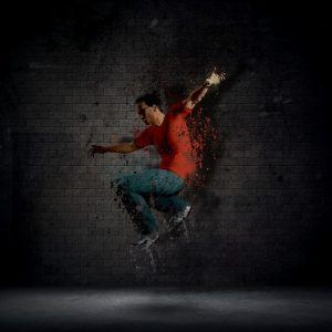 man-dancing-against-a-dark-brick-wall_1048-2895